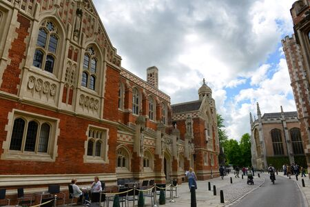 british: Pedestrians Walking on St Johns Street in front of Newly Renovated Divinity School, Cambridge University, England Editorial