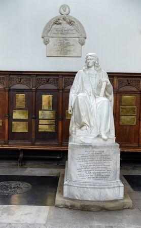 mathematician: Statue of Isaac Barrow Beneath Browne Plaque Inside Trinity College Chapel, Cambridge University, England Editorial