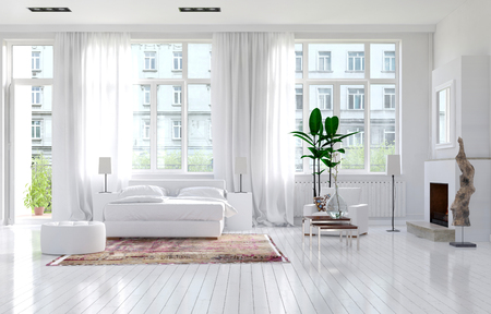 living room: Large spacious monochromatic white bedroom with fireplace, a double bed and large view windows with long elegant drapes in a luxury apartment. 3d Rendering. Stock Photo