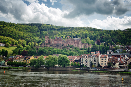 forested: View of Heidelberg Castle and Town on the Banks of Neckar River, Surrounded by Lush Forested Hillsides, Heidelberg, Baden-Wurttemberg, Germany Editorial