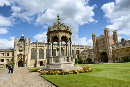 university fountain: View of the Great Court, Trinity, Cambridge University, Cambridge, UK and the ornate central stone fountain with the Kings Gate and Great Gate behind