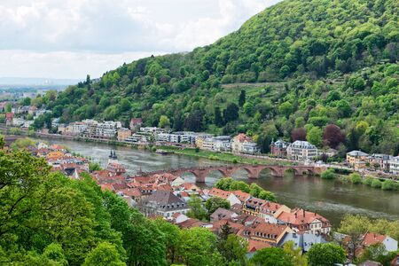 spanned: Overview of Old and New Town Neighborhoods on Banks of Neckar River Spanned by Old Bridge, Heidelberg, Baden-Wurttemberg, Germany