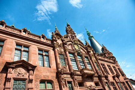 ornately: Low Angle View of Heidelberg University Library, Ornately Decorated Facade Above Entrance Against Blue Sky, Heidelberg, Baden-Wurttemberg, Germany
