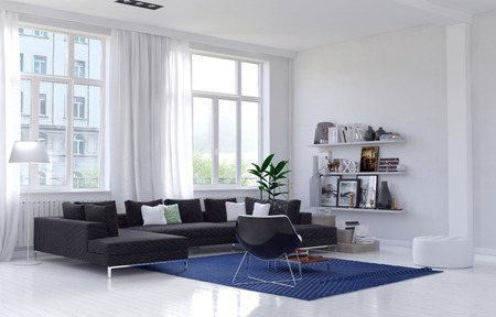 Spacious bright sunny living room interior with a comfortable charcoal lounge suite and armchair on a blue rug in a corner below large windows with long white drapes, wall unit with personal mementos. 3d Rendering. Banque d'images