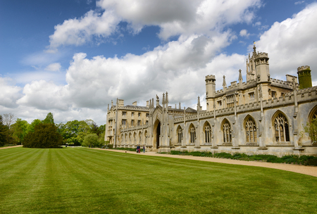 upper school: Scenic View of St Johns College New Court Gate Way Situated on Vast Green Lawn Under Blue Sky, University of Cambridge, England Editorial