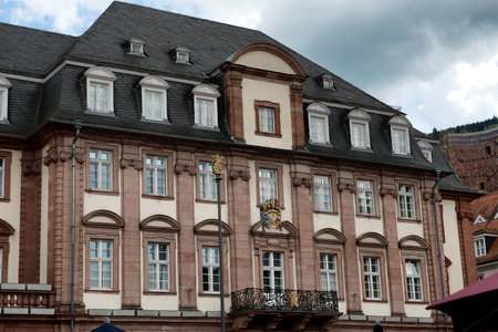 Close Up of Facade of Historic Town Hall with Dark Clouds in Sky, Heidelberg, Baden-Wurttemberg, Germany photo