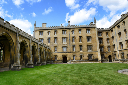 cambridgeshire: Architectural Exterior of Facade of Historical Buildings at St Johns College, University of Cambridge, England, as seen from Inside Lush Green New Court Editorial