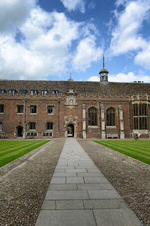 leading the way: Surface Level View of Walk Way Leading Through Archway in Second Court of St Johns College, University of Cambridge, England