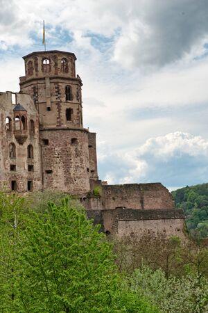 nestled: Ruins of Historic Heidelberg Castle Nestled in Lush Green Hillsides Overlooking Heidelberg, Baden-Wurttemberg, Germany