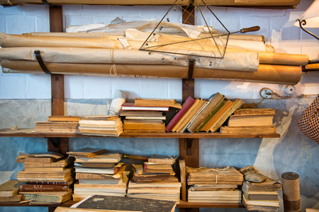 bookshop: Antique Old Aged Books stacked on a wooden surface Stock Photo