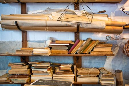 tomes: Antique Old Aged Books stacked on a wooden surface Stock Photo