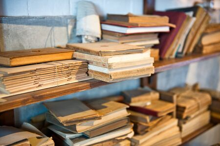 olden day: Antique Old Aged Books stacked on a wooden surface Stock Photo