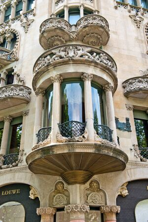 balcony window: Ornate semi-circular Art Nouveau balcony and bay window on the exterior of a historic stone Spanish building in Barcelona, Spain