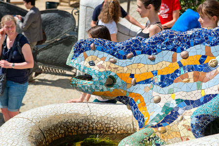 popularly: BARCELONA, SPAIN - MAY 02: Gaudís multicolored mosaic salamander, popularly known as el drac (the dragon) at Parc Guell in Barcelona, Spain on May 02, 2015