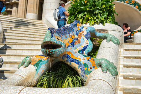 popularly: BARCELONA, SPAIN - MAY 02: Gaudís multicolored mosaic salamander, popularly known as el drac (the dragon) at Parc Guell in Barcelona, Spain on May 02, 2015 Editorial