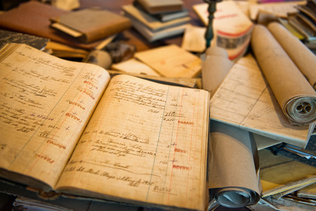 messy desk: Antique Old Aged Books stacked on a wooden surface Editorial