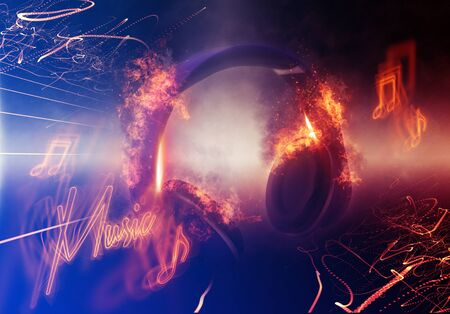 lit: Modern Illuminated Headphones with Fire Effect Dramatically Lit from Side with Small Light Beams and Music Slogan Stock Photo