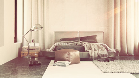 flanked: Luxury bedroom interior with grey decor and a contemporary upholstered bed flanked by long drapes with scattered throw rugs , an ottoman and lamp Stock Photo
