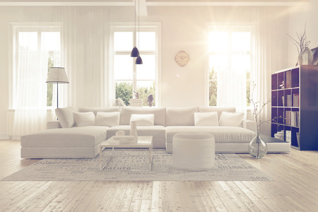 living room: Modern spacious lounge or living room interior with monochromatic white furniture and decor below three tall bright windows with a dark bookcase accent in the corner