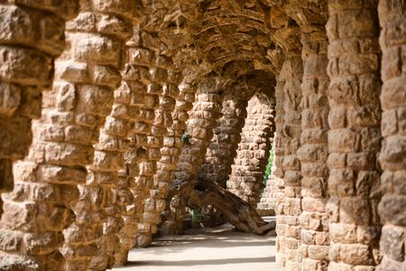 guell: Sloped columns and covered walkway at the Guell Park, Barcelona, Spain Stock Photo