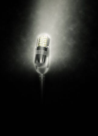 dramatically: Old Microphone on dark background dramatically lit from above
