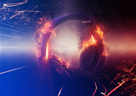 dramatically: Modern Illuminated Headphones with Fire Effect Dramatically Lit from Side with Small Light Beams