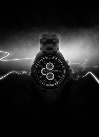opulence: Luxury Design Black Wristwatch Lit Dramatically from Side on Dark Background with White Light Rays