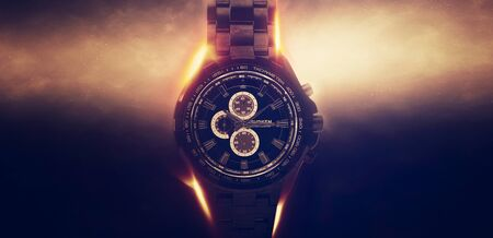 chronograph: Luxury Design Black Wristwatch Chronograph Lit Dramatically from Side on Dark Background with Glowing Effect
