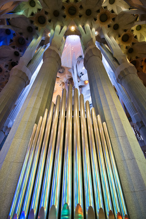 fluted: Organ pipes in the Sagrada Familia, Barcelona, Spain between fluted columns designed by Antoni Gaudi to resemble branching trees Editorial