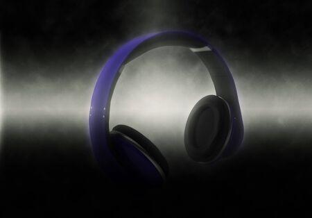 lit: Modern Illuminated Headphones on Dark Background dramatically Lit from Side Stock Photo