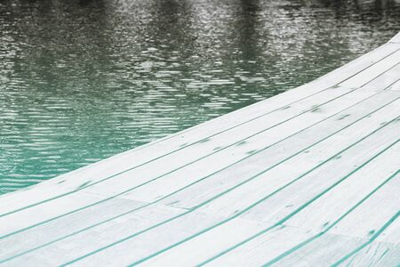 decking: Close Up of Swimming Pool Surrounded by Wooden Decking