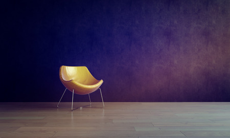 modern chair: Single Modern Gold Colored Chair in Empty Room with Dark Gray Walls and Smooth Wooden Floor, in Warm Lighting Stock Photo