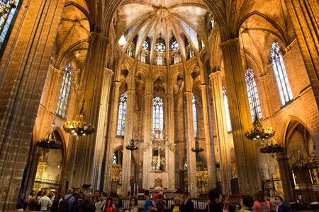 barcelona cathedral: Low Angle Architectural View of Interior of Historic Barcelona Cathedral, Looking Up at Vaulted Nave Ceiling Illuminated in Warm Light Editorial