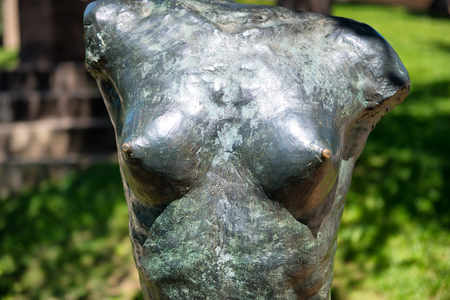 naked statue: Torso statue of a naked female with a close up frontal view of her bare breasts in Poble Espanyol, Barcelona, Spain