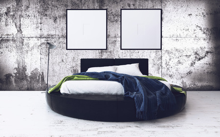 outworn: Round Bed and Minimalist Framed Artwork in Modern Loft Bedroom with Exposed Concrete Walls - Contemporary Bedroom with Industrial Feel
