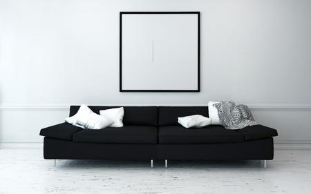 壁でシンプルなアートワークでまばらに飾られたモダンなリビング ルームの白いクッションが付いている黒いソファー