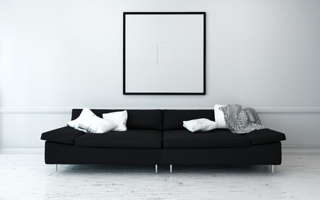 living room sofa: Black Sofa with White Cushions in Sparsely Decorated Modern Living Room with Minimalist Artwork on Wall