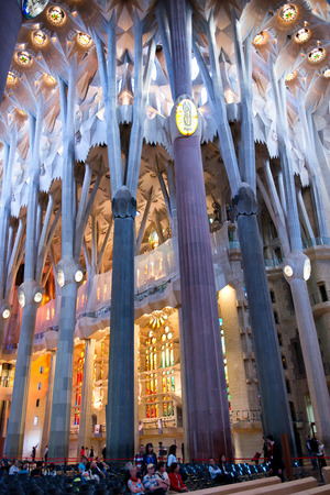 sagrada familia: Architectural Interior Detail of Pillars and Stained Glass Inside Sagrada Familia Church, Designed by Antoni Gaudi, Barcelona, Spain