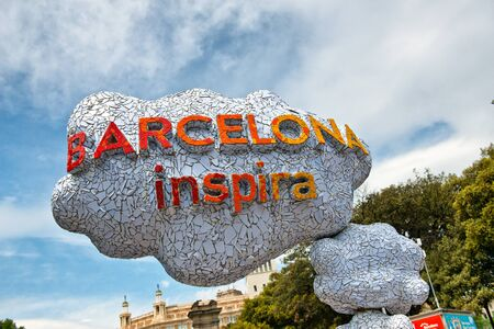 inventiveness: Low Angle View of Barcelona Inspira Slogan on Cloud Shaped Art Installation Piece in Barcelona, Spain