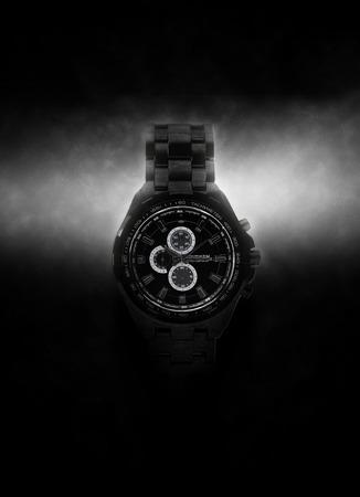 opulence: Luxury Design Black Wristwatch Lit Dramatically from Side on Dark Background Stock Photo
