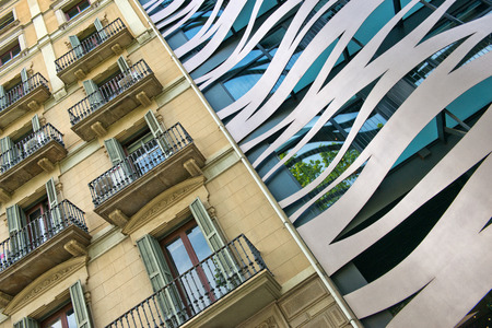 Tilted Architectural Detail View of Old and New Neighboring Buildings Located on Passeig de Gracia, Barcelona, Spain 報道画像