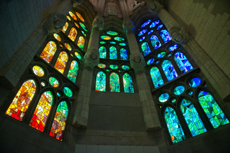 Low Angle View of Colorful Stained Glass Windows Viewed from Interior of Sagrada Familia Church, Designed by Antoni Gaudi, Barcelona, Spain Editorial