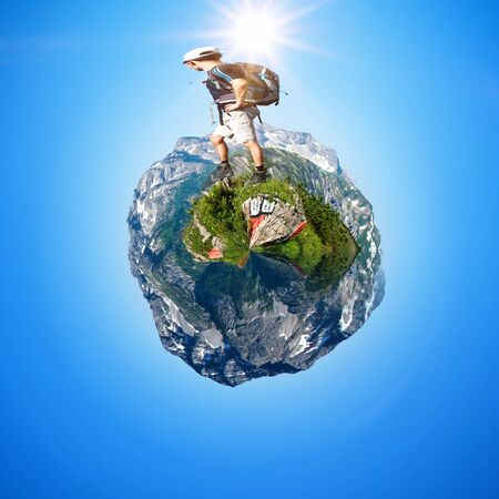 treading: Male Hiker Treading on Abstract Fish Eye Mountain Globe Scenic Under Bright Sunlight - Concept Travel Exploration Image Stock Photo
