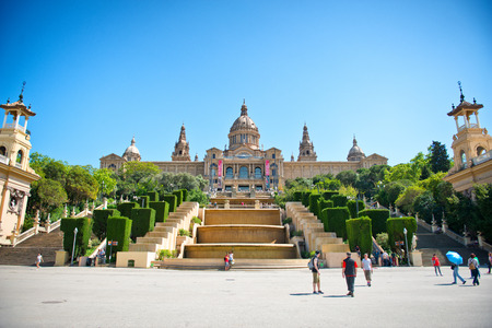 art museum: Exterior of Palau Nacional on Montjuic Hill in Barcelona, Spain - on Sunny Day with Clear Blue Sky - a Popular Tourist Attraction