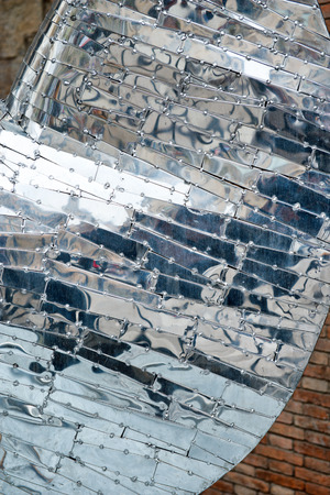 reflection in mirror: Close Up Abstract Detail of Reflective Metal Architectural Element, Designed by Antoni Gaudi, in Barcelona, Spain