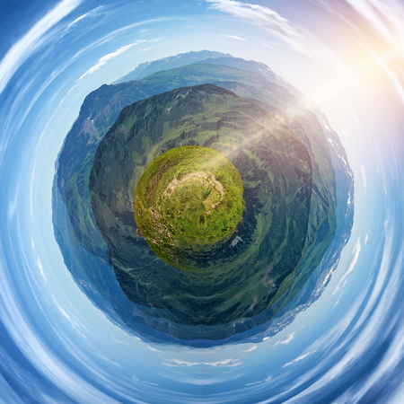 sunlight earth: Extreme Fish Eye View of Green Valley and Mountain Range Globe with Blue Sky and Bright Sunlight