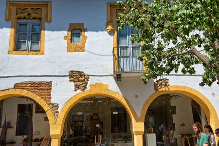 archways: Architectural Detail of Yellow Building Archways in Sunny Plaza, Poble Espanyol Museum District, Barcelona, Spain Editorial