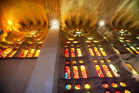 sagrada familia: Low Angle View of Stained Glass Glowing in Warm Exterior Sunlight - Architectural Interior View of Sagrada Familia, Designed by Antoni Gaudi, Barcelona, Spain