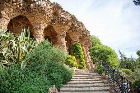 guell: Sloped columns and covered walkway at the Guell Park, Barcelona, Spain which are the load bearing supports for the viaduct on the el Carmei Hill