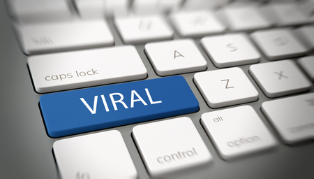 viral: Viral online marketing, brand awareness or meme concept with the word - Viral - on a blue enter button on a computer keyboard with blur vignette Stock Photo